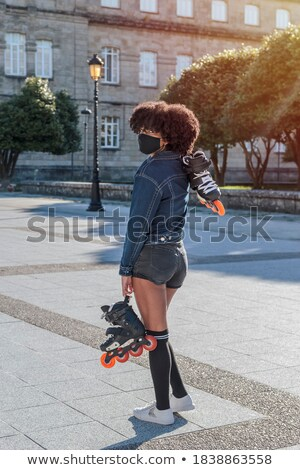 Sportive woman wearing rollers Stock photo © dash