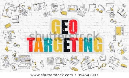 Geo Marketing on White Brick Wall. Stock photo © tashatuvango