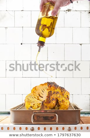 roasted yellow cauliflower over a metallic oven tray stock photo © photooiasson