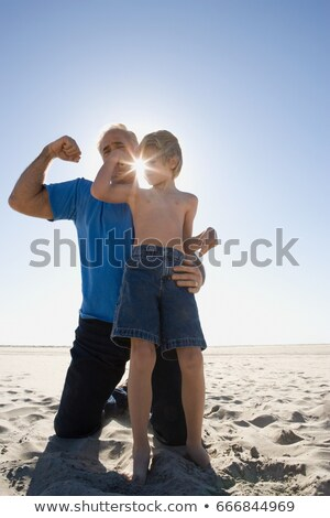 Grand-père fils biceps plage enfant muscle Photo stock © IS2