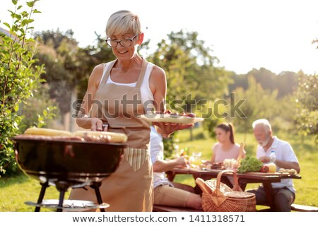 Happy senior women preparing picnic table Stock photo © wavebreak_media