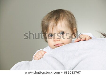 Baby peeping over a cushion Stock photo © IS2