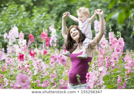 mooie · zwangere · vrouw · tuin · permanente · bomen - stockfoto © janpietruszka