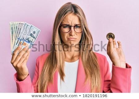 Bitcoin to dollar currency exchange. Bitcoin. Dollar coin. Cryptocurrency. Golden coins with Bitcoin Stock photo © ikopylov