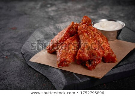 Sauces and chicken wings on parchment Stock photo © dash