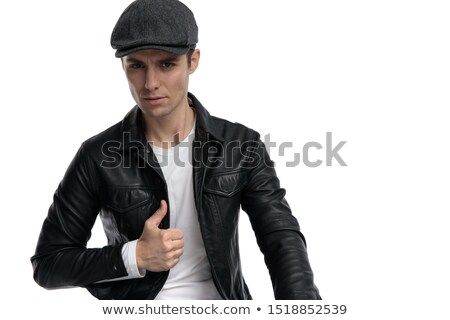 portrait of seated casual man wearing leather jacket smiling stock photo © feedough