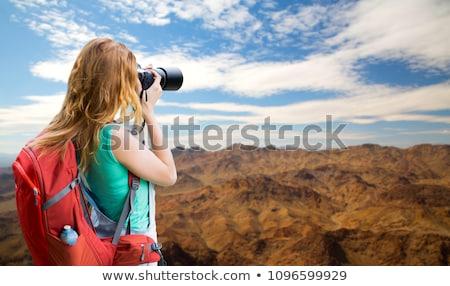 woman with backpack and camera at grand canyon Stock photo © dolgachov