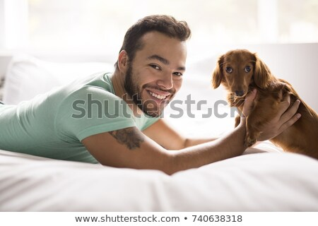 молодые привлекательный мексиканских человека домой кровать Сток-фото © Lopolo