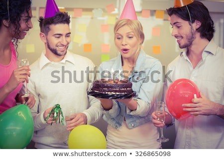 excited businesswoman casually dressed celebrates while holding stock photo © feedough