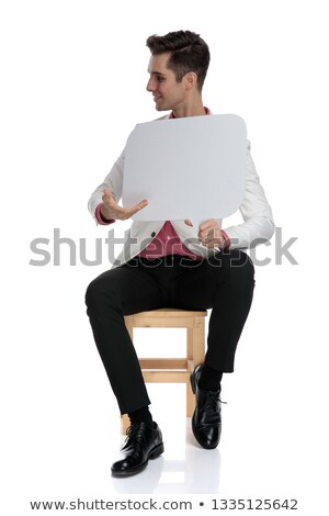 young businessman recommends a blank speech bubble to side stock photo © feedough