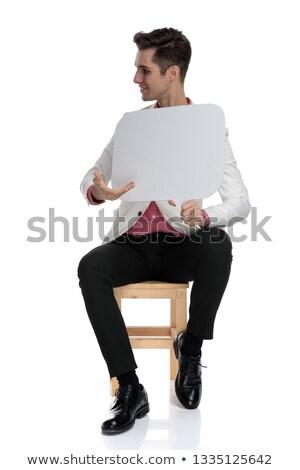 Fiatal üzletember szövegbuborék oldal ül szék Stock fotó © feedough