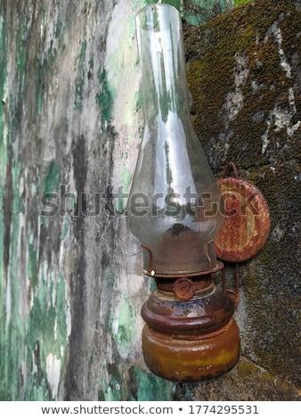 Old oil lamp on lotus lake Bali, Indonesia Stock photo © galitskaya