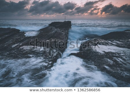 Dawn Skies, Moody Seas and Rocky Chasms Landscapes Stock photo © lovleah