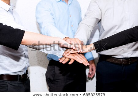 happy team at office party holding hands together stock photo © dolgachov