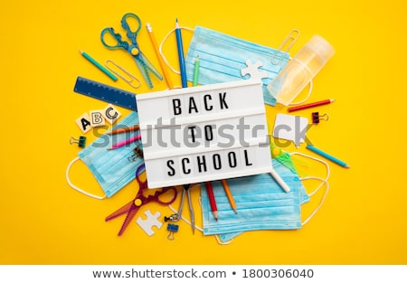 back to school pupils in classroom stationery stock photo © robuart