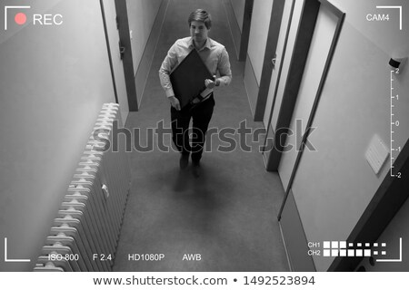 Footage Of Man Stealing Computer Monitor Walking In Corridor Stock photo © AndreyPopov