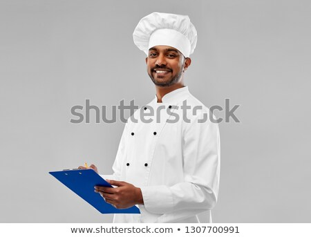 happy male indian chef in toque with clipboard Stock photo © dolgachov