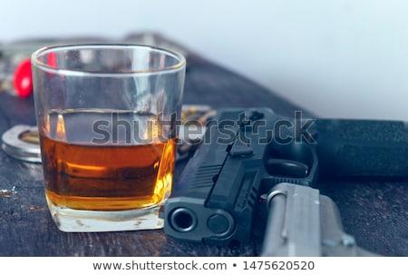 Férfi fegyver emberi kéz tart mögött öv Stock fotó © simazoran