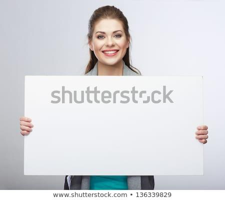 Lezser boldog nő tart óriásplakát kettő Stock fotó © Lopolo