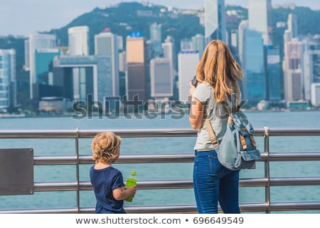 Young woman and her son taking photos of victoria harbor in Hong Kong, China Stock photo © galitskaya
