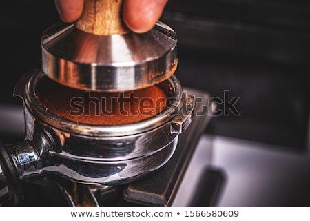Barista pressing ground coffee Stock photo © grafvision