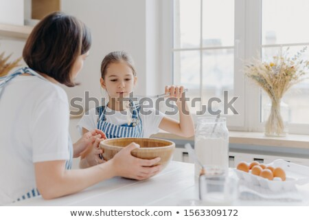 Adorable peu enfant tablier fouet blanche Photo stock © vkstudio