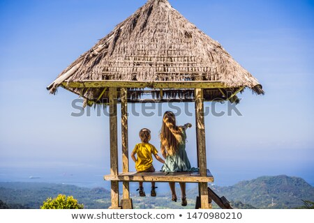 Mom and son in a gazebo in Bali. Traveling with kids concept. Kids Friendly places Stock photo © galitskaya
