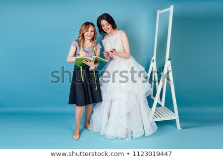 Discussing details of wedding dress Stock photo © pressmaster