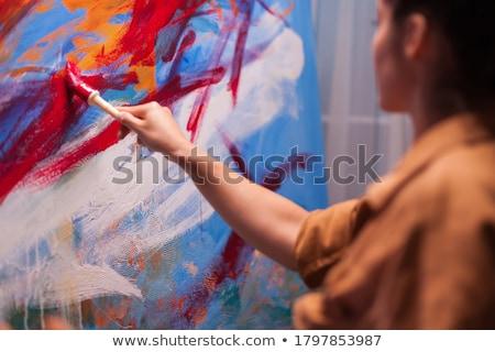 Kéz tart ecset művészi szerszám neon Stock fotó © yupiramos