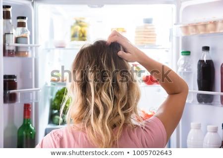 Verwechselt hungrig Frau schauen öffnen Kühlschrank Stock foto © AndreyPopov