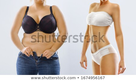 Surprised woman after loosing weight, isolated on white Stock photo © Nobilior