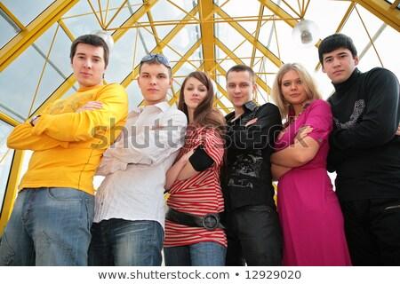 группа молодые люди пешеходный мост мнение женщину Сток-фото © Paha_L