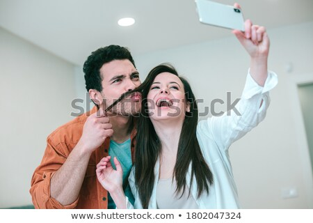 romantic image of a male and female couple with lips locked in a stock photo © dacasdo