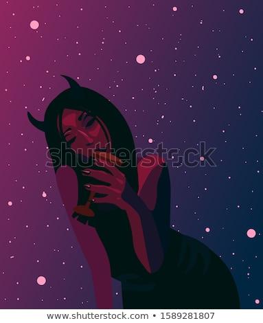 Demoniczny kobiet młodych piękna posiedzenia Zdjęcia stock © sapegina