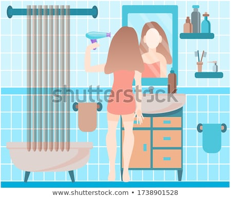 Beautiful woman drying her hair with hairdryer Stock photo © HASLOO