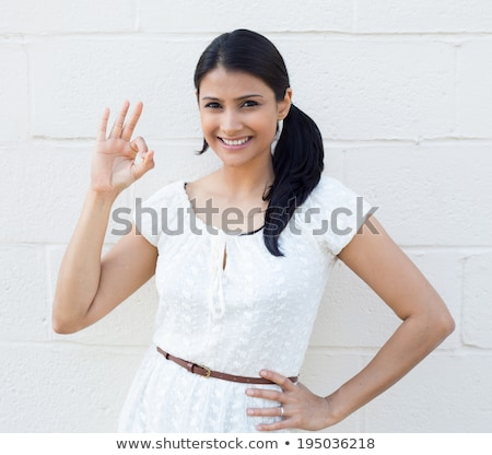 Young woman giving the okay sign Stock photo © photography33