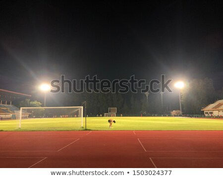 It is a man running in play gorund lanes on a track Stock photo © cozyta