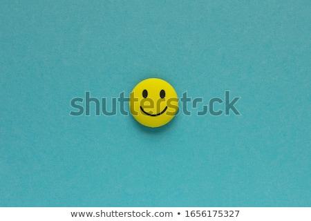 Rosto sorridente azul isolado branco sorrir cara Foto stock © zeffss