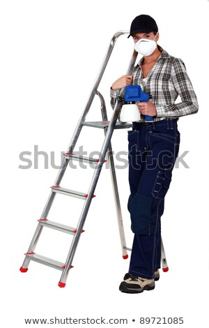 craftswoman on a ladder holding a sprayer and wearing a mask Stock photo © photography33
