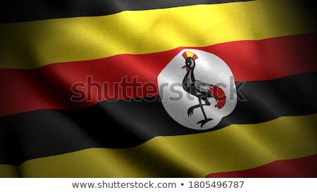 Political waving flag of Uganda Stock photo © perysty