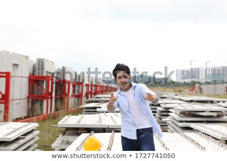 female construction worker pointing with both hands stock photo © photography33