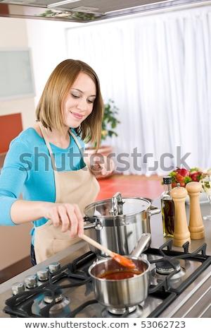Woman stirring sauce Stock photo © photography33