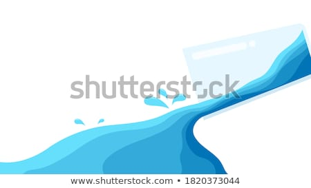 glass with pouring water stock photo © oneinamillion