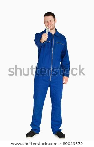 Sorridente jovem mecânico terno chave inglesa Foto stock © wavebreak_media