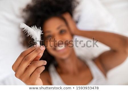Młoda dziewczyna świetle Pióro skóry gradient moda Zdjęcia stock © ra2studio