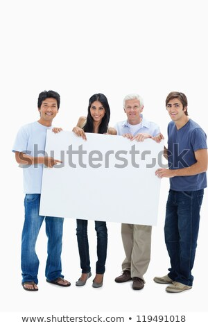 casual young people showing a big blank banner and smile stock photo © feedough