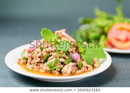 Piccante carne di maiale riso alla griglia cena carne Foto d'archivio © AEyZRiO
