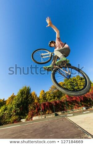 boy going airborne with his  bike Stock photo © meinzahn