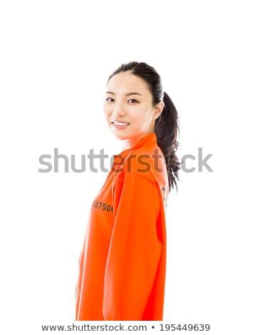 Jungen asian Frau lächelnd einheitliche Frau orange Stock foto © bmonteny