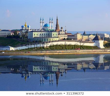 kazan kremlin with reflection in river at sunset stock photo © mikko